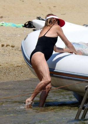 Goldie Hawn in Black Swimsuit on a boat in Greece