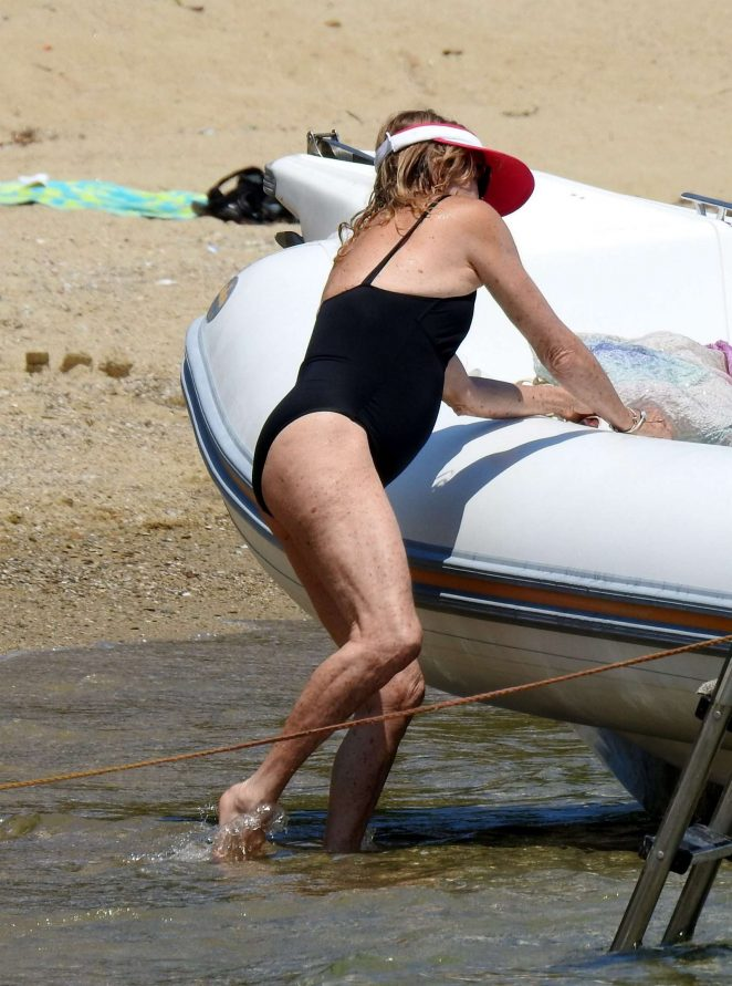 Goldie Hawn in Black Swimsuit on a boat in Greece