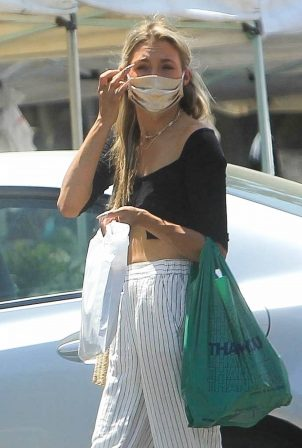 Greer Grammer - Shopping at a farmer's market in West Hollywood