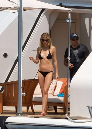 Gwyneth Paltrow in Black Bikini on a yacht in St. Tropez