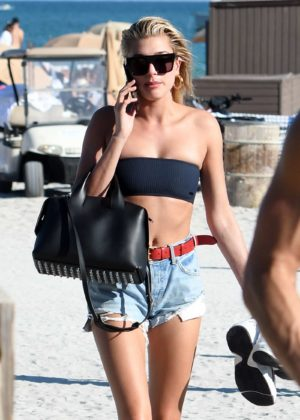 Hailey Baldwin in Black Bikini Top on the beach in Miami