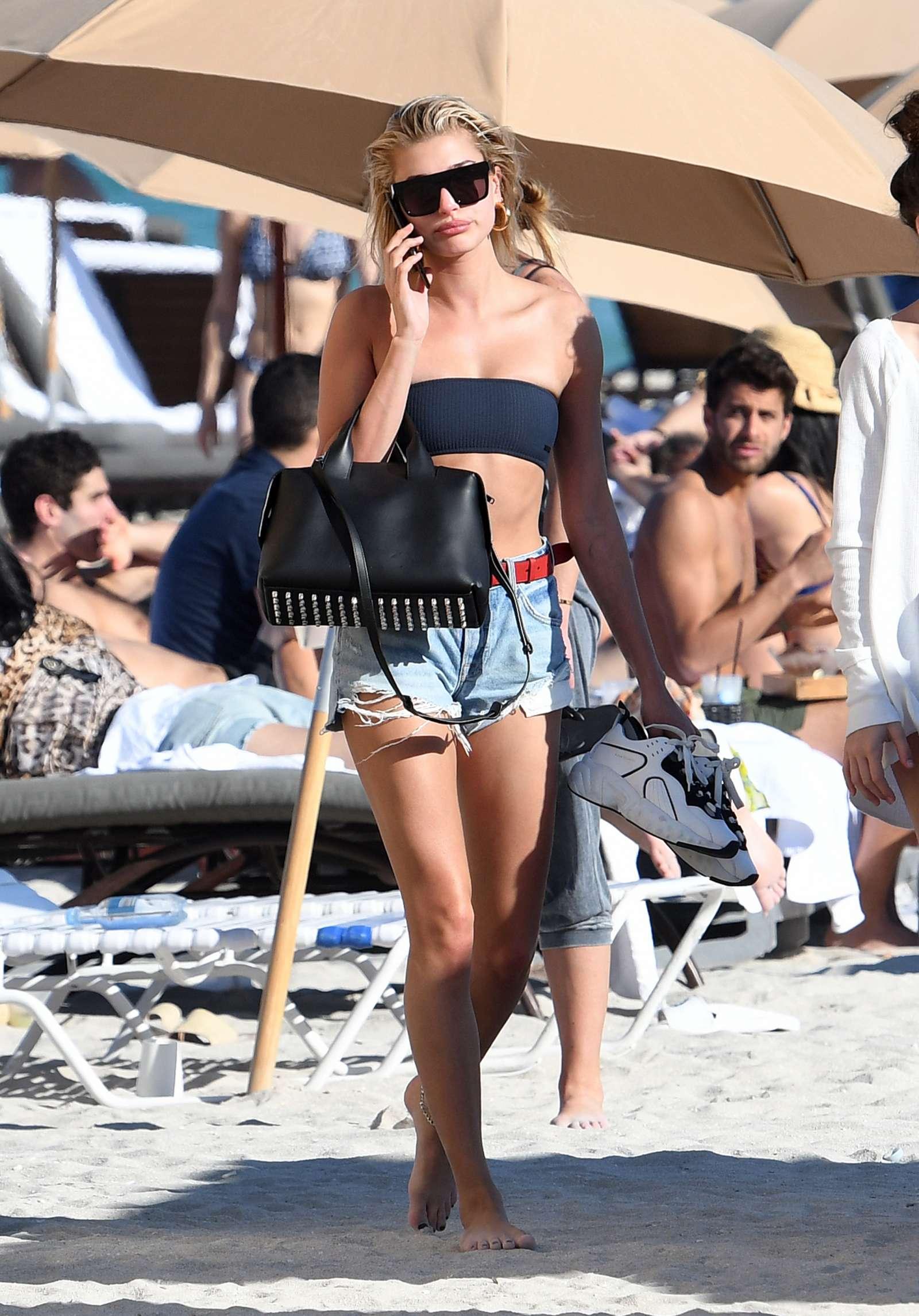 Hailey Baldwin in Black Bikini Top on the beach in Miami Pic 17 of 35