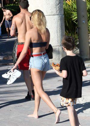 Hailey Baldwin in Black Bikini Top on the beach in Miami Pic 5 of 35