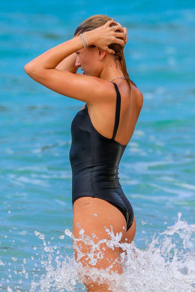 Hailey Baldwin in Swimsuit on the beach in Oahu