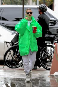 Hailey Bieber - In a green oversized jacket at Cha Cha Matcha in Los Angeles