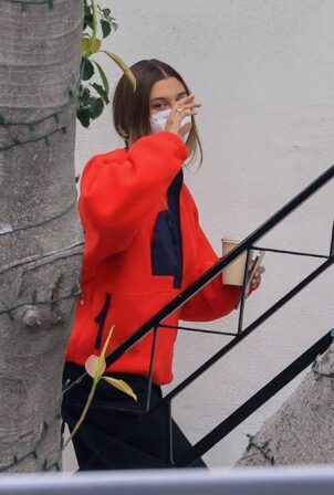 Hailey Bieber - In a red sweater out in Los Angeles