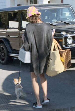 Hailey Bieber - Steps out with her puppy in Santa Barbara