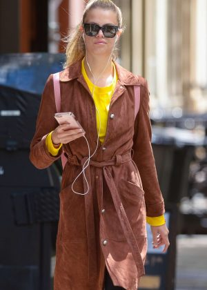 Hailey Clauson listens to music out in New York