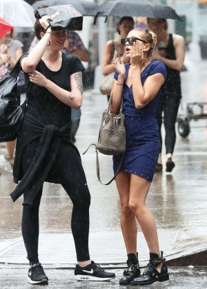 Hailey and Ireland Baldwin on a Rain in NYC