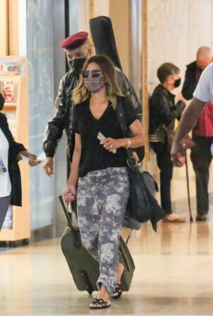Halle Berry - With Van Hunt pictured departing from Orlando