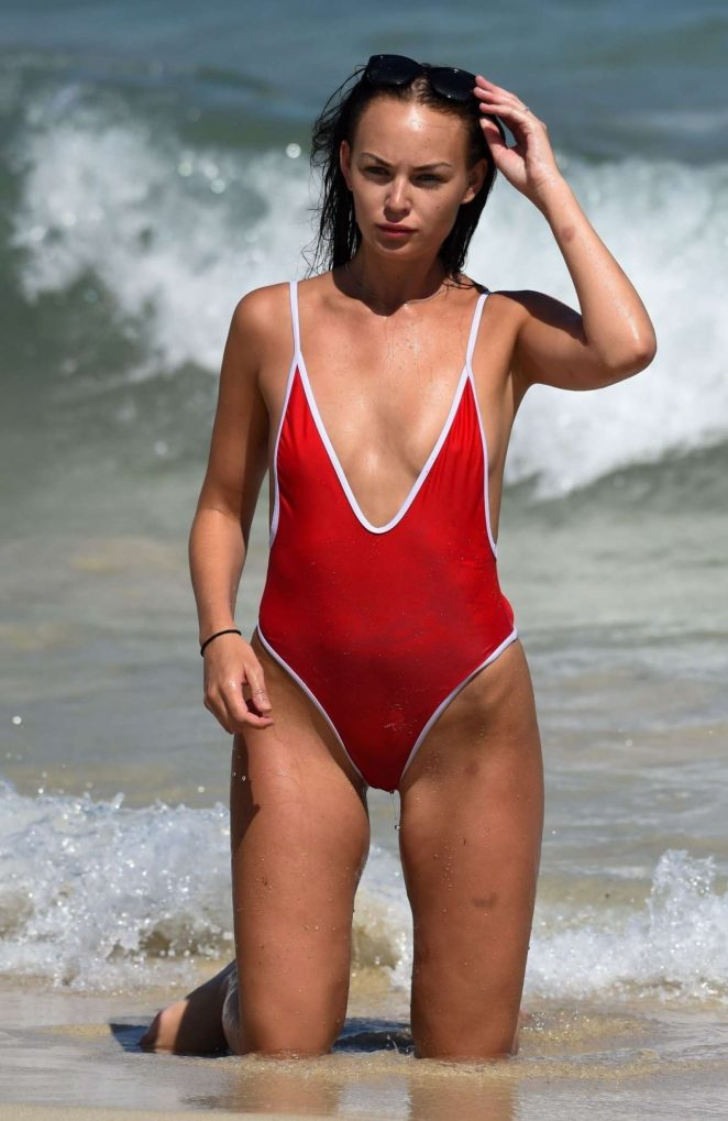 Hayley Fanshawe in Red Swimsuit on the beach in Magaluf