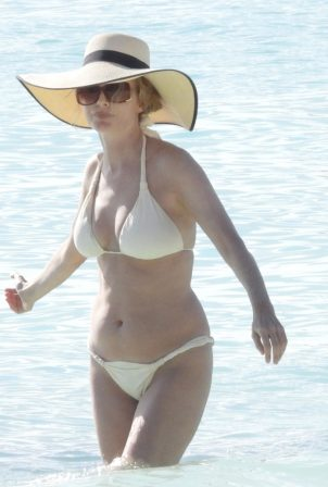 Heather Graham - Hits the beach in a white bikini in Tulum