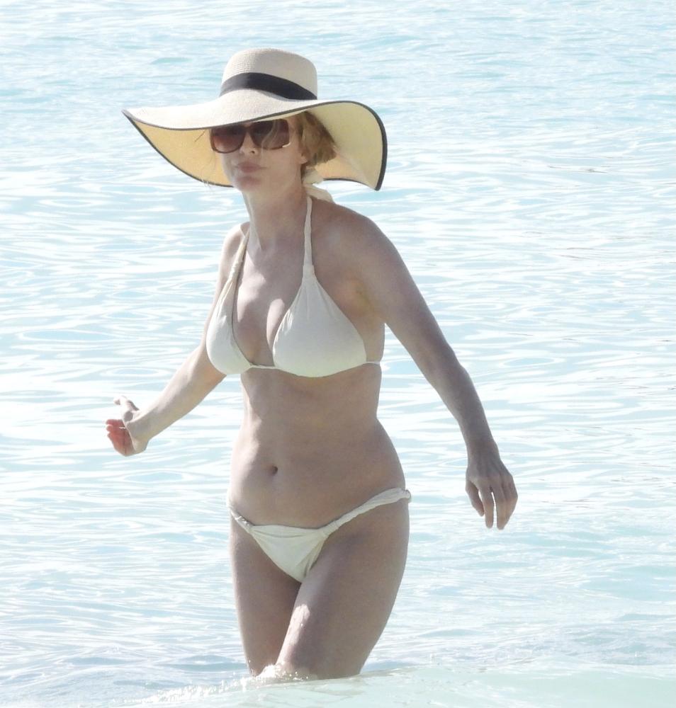 Heather Graham - Hits the beach in a white bikini in Tulum