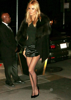 Heidi Klum in Mini Skirt at the Caryle Hotel in New York
