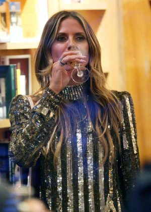 Heidi Klum in a gold dress at a party in New York City