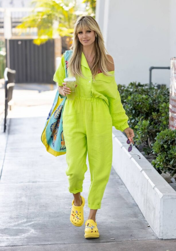 Heidi Klum - In a neon yellow jumpsuit steps out in Los Angeles