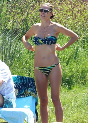 Heidi Klum in Bikini at the beach in Corsica