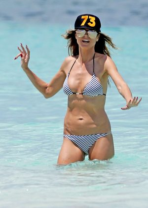 Heidi Klum in Bikini on the beach in Caribbean