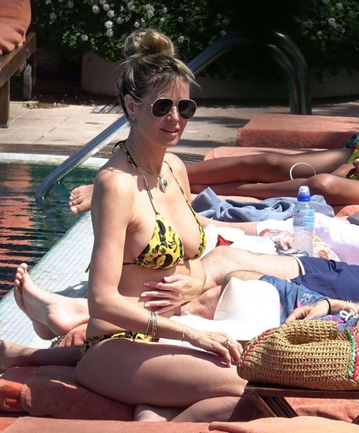 Heidi Klum in Bikini on the pool in Capri