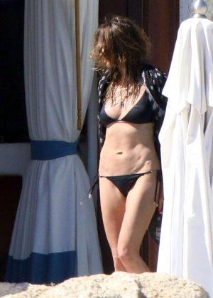 Heidi Klum in Black Bikini on the pool in Cabo San Lucas