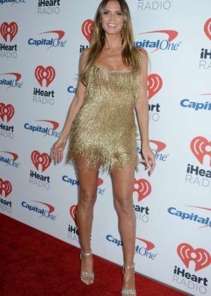 Heidi Klum - In Gold mini dress at iHeart Radio Festival Day 1 in Las Vegas