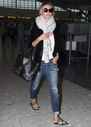 Heidi Klum in Jeans at Heathrow Airport in London
