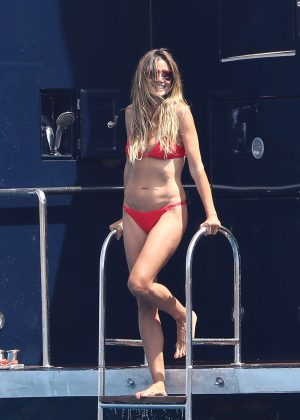Heidi Klum in Red Bikini on a yacht in Saint Tropez