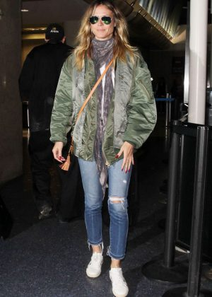 Heidi Klum in Ripped Jeans at LAX Airport in LA