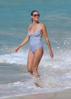 Heidi Klum in Swimsuit on the beach in Caribbean