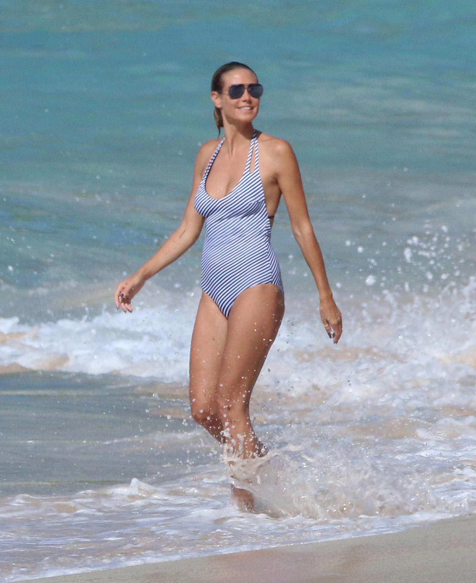 Heidi Klum in Swimsuit on the beach in Caribbean