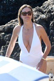 Heidi Klum in White Swimsuit at the beach in Capri