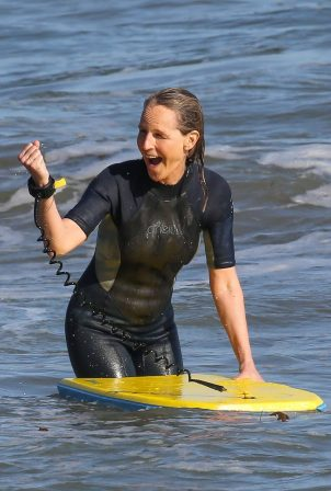 Helen Hunt - Bodyboarding at a beach in Malibu