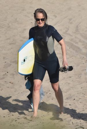 Helen Hunt - Bodyboarding session with a friend in Malibu