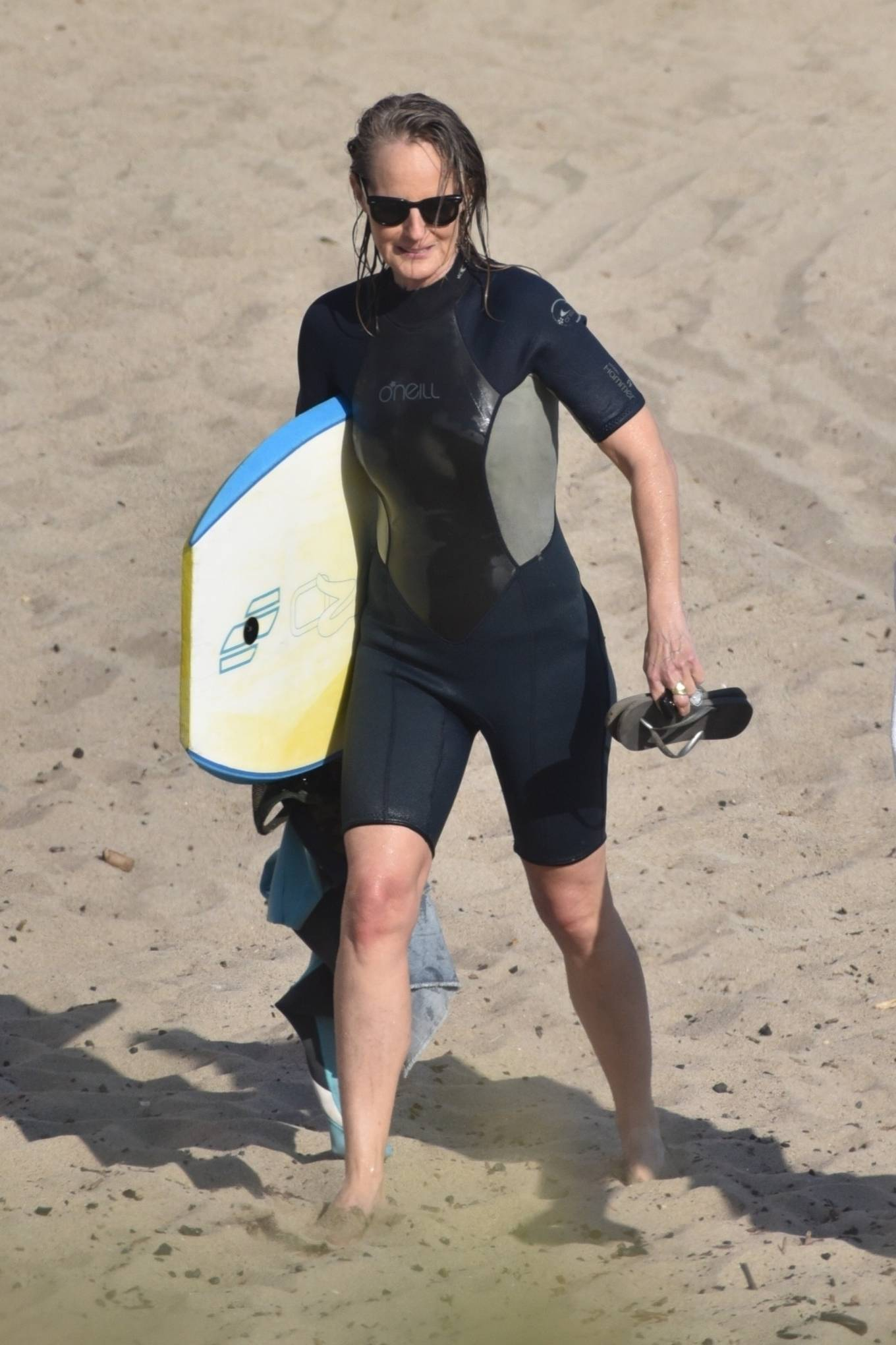 Helen Hunt - Bodyboarding session with a friend in Malibu