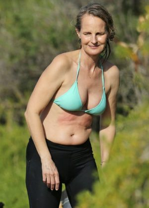 Helen Hunt in Bikini Top surfing in Hawaii