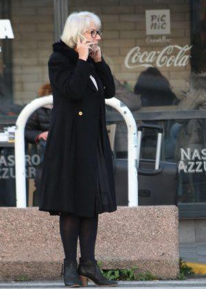 Helen Mirren in Black Coat Arrives in Naples