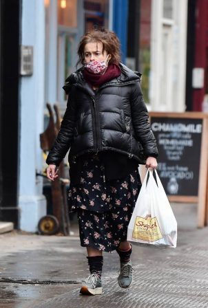 Helena Bonham Carter - In a puffer jacket and floral dress running errands in North London