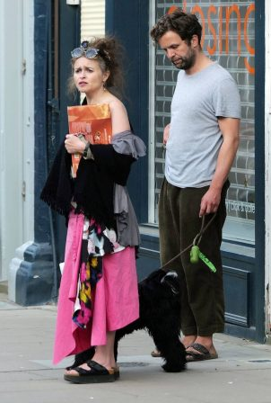 Helena Bonham Carter with her boyfriend walking her dog in North London