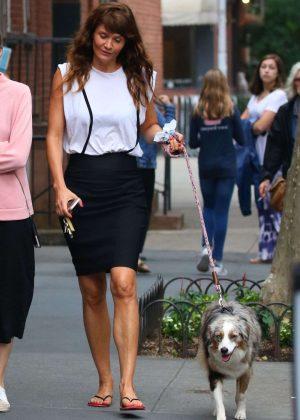 Helena Christensen in Black Skirt walking her dog in New York