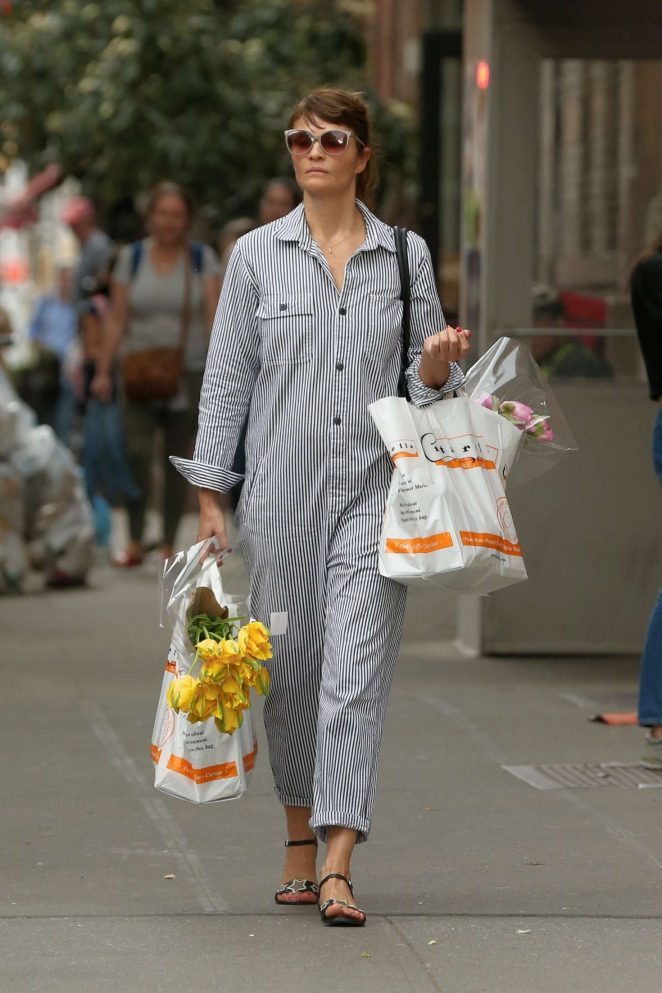 Helena Christensen in Pin-striped jumpsuit in West Village