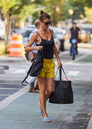 Helena Christensen in Yellow Shorts out in New York City