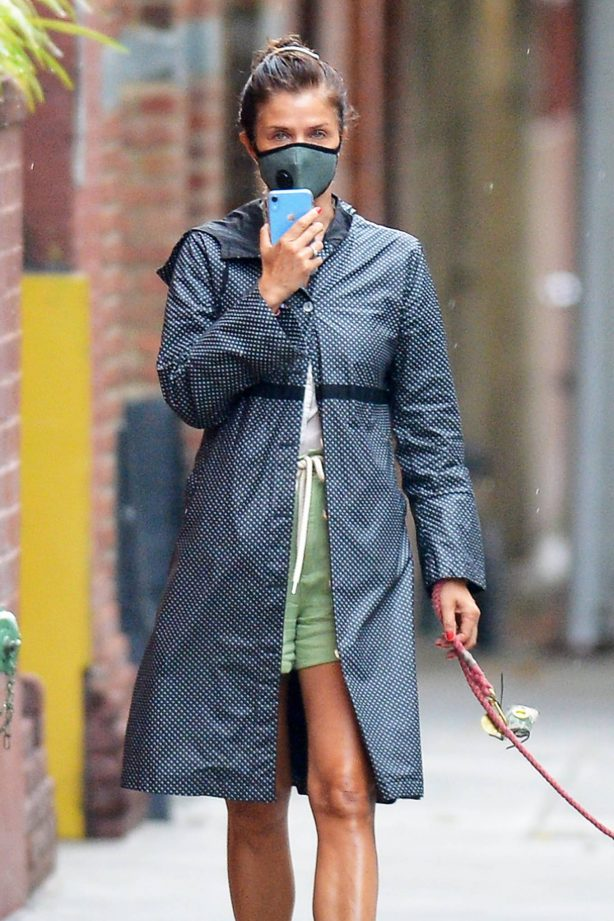 Helena Christensen - Walking her dog during a break in the rain in New York City