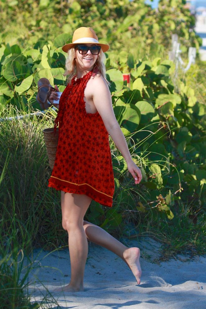 Helene Yorke in Red Dress spends her birthday on a Miami Beach