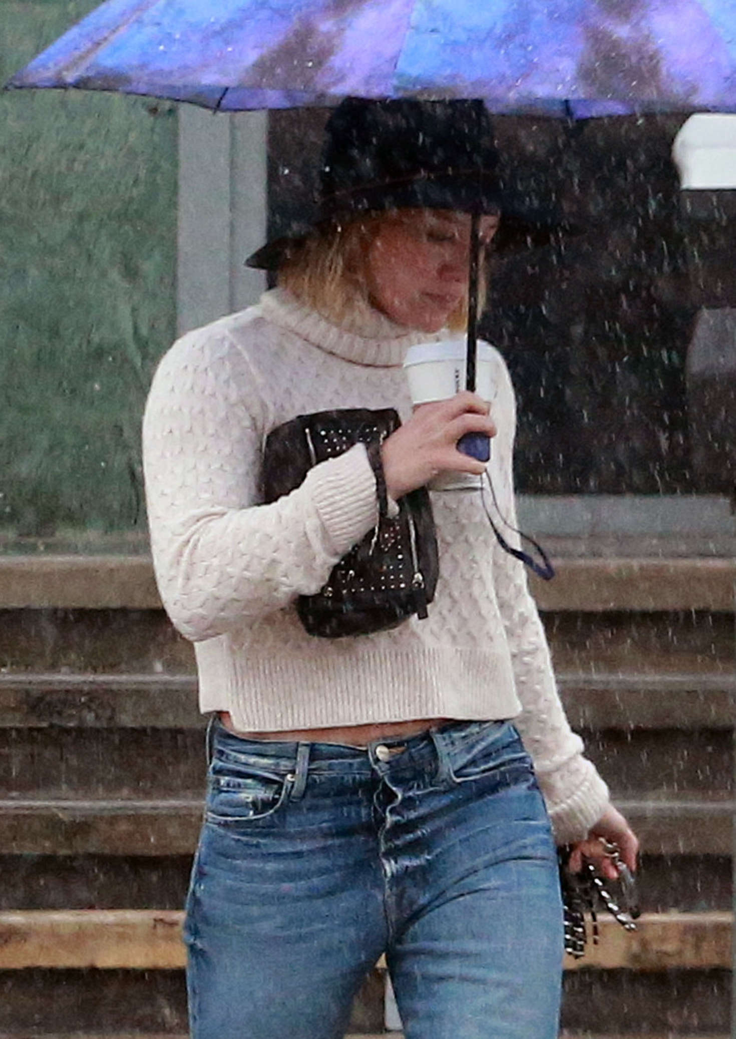 Hilary Duff in Jeans out on a rainy day in Los Angeles