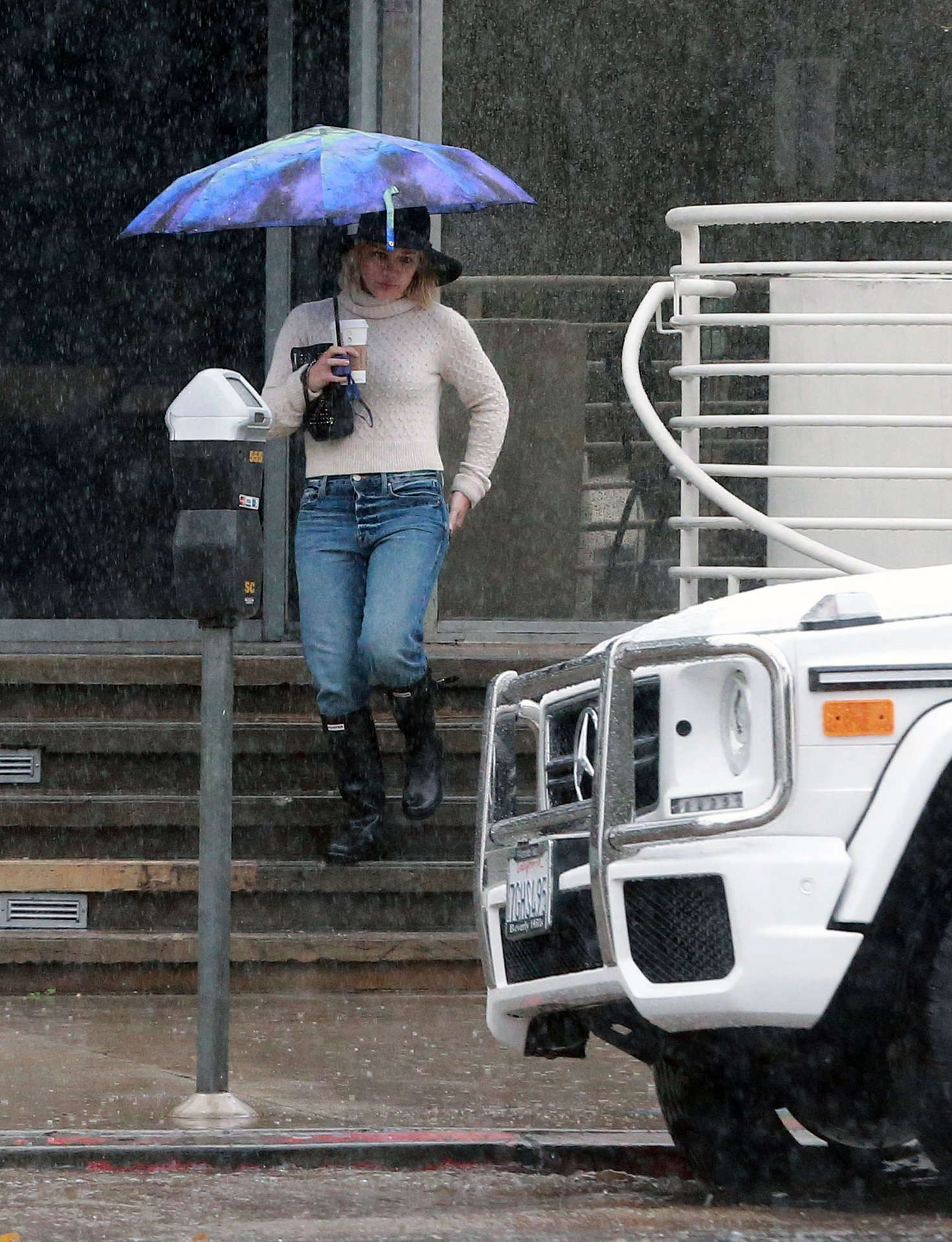Hilary Duff 2016 : Hilary Duff in Jeans out on a rainy day -24