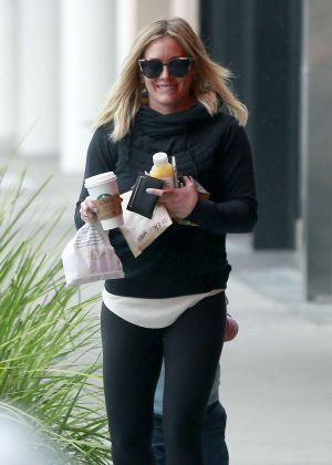 Hilary Duff in tights getting gas in Beverly Hills