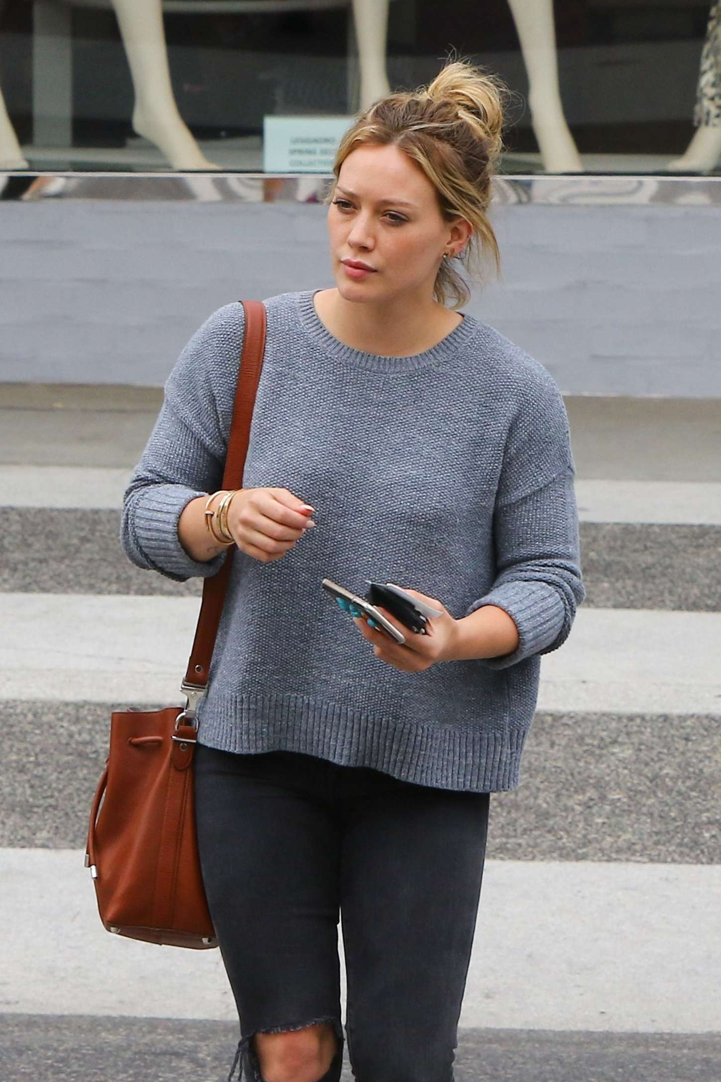 Hilary Duff in Ripped Jeans out for lunch in Beverly Hills