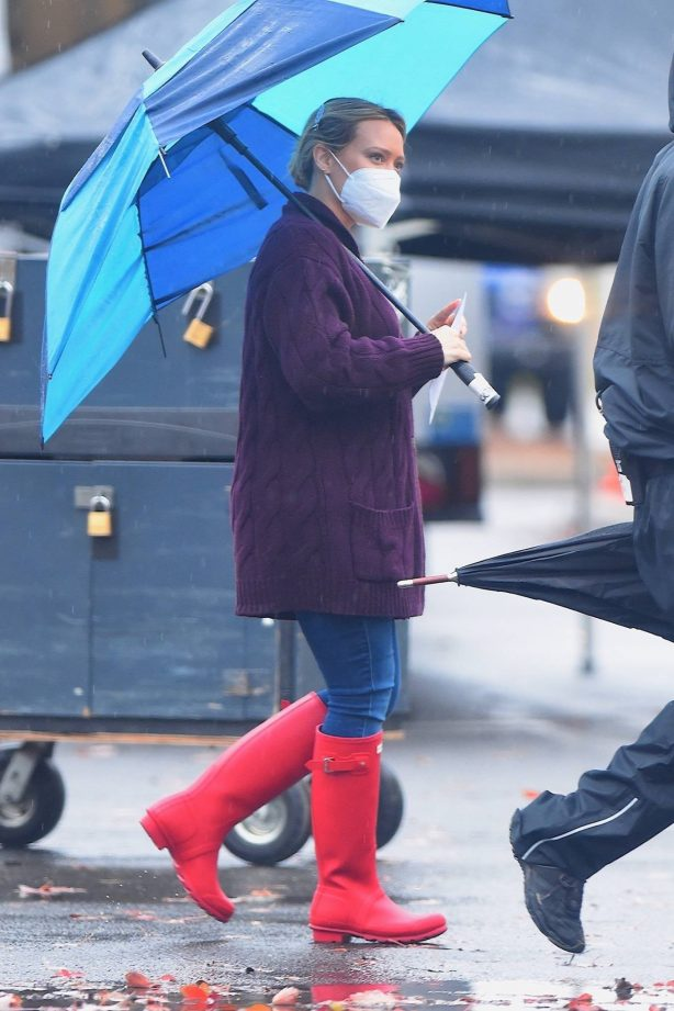 Hilary Duff - Seen on the rain on the set of 'Younger' in Westbury