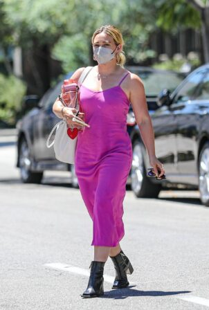 Hilary Duff - Wears a hot pink dress in Beverly Hills