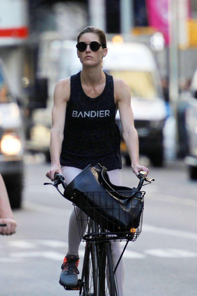 Hilary Rhoda rides her bike in New York City